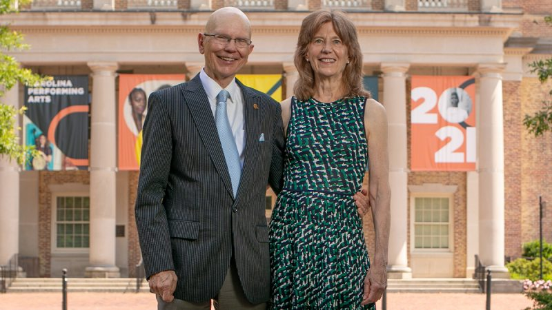 James and SusanMoeser standing outside Memorial Hall.