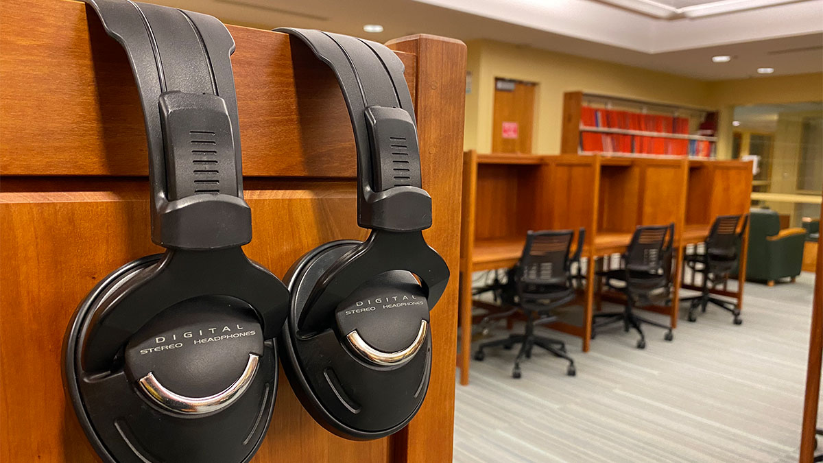 headphones draped over the side of a desk.