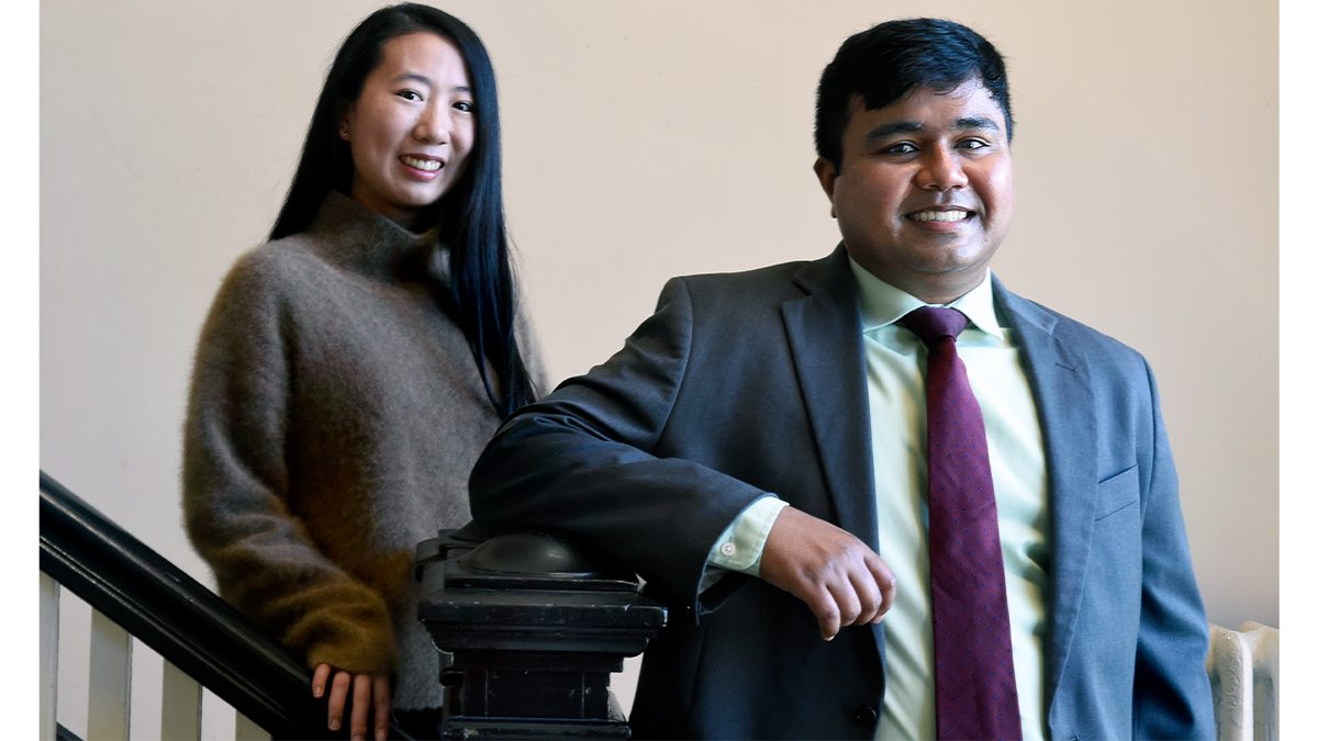 Jiayi Bao and Abhisekh Ghosh Moulick stand together near stairs.