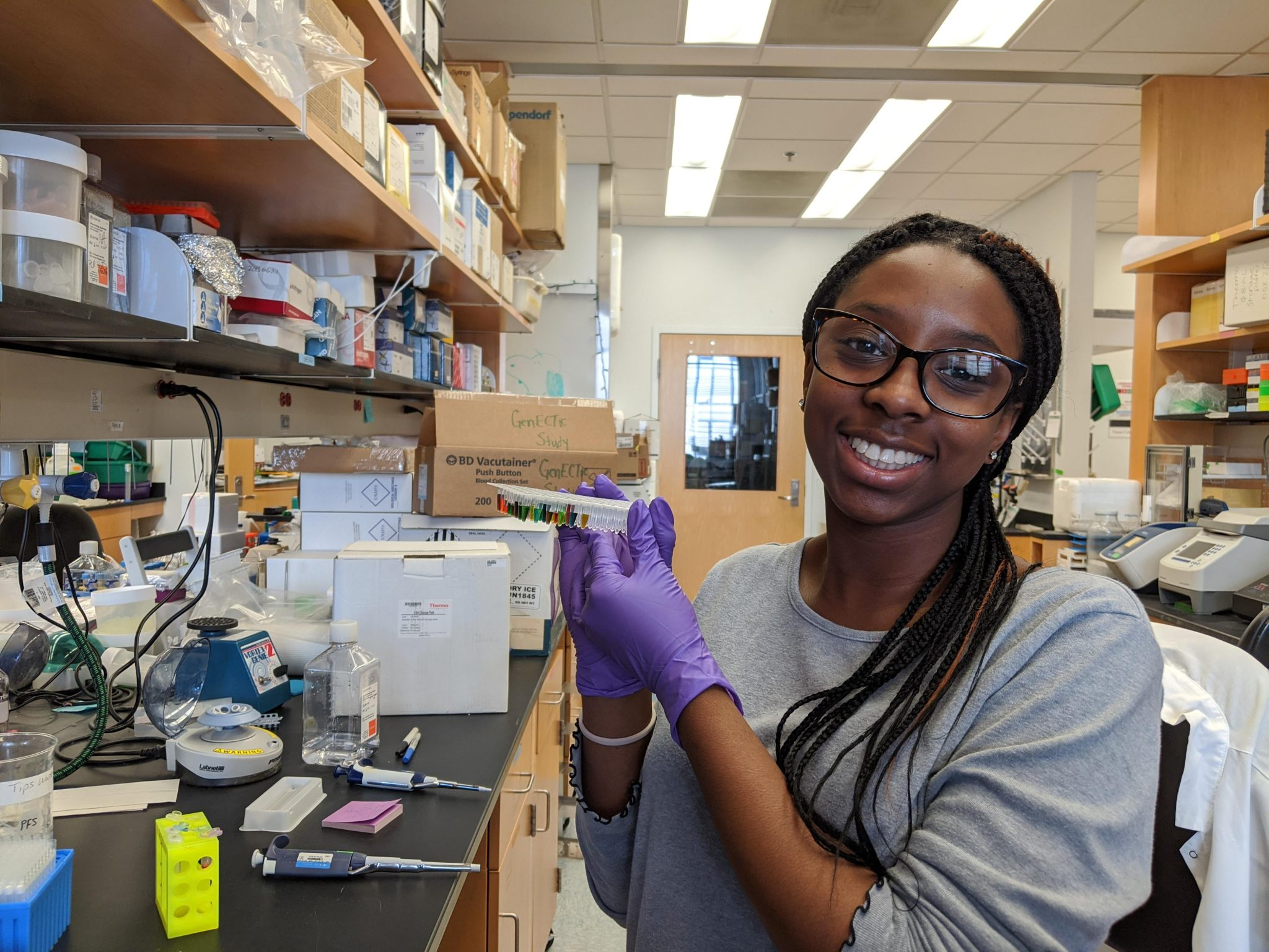 Jasmine Akoto working in a research lab.