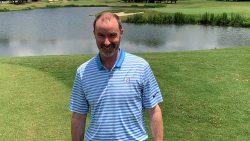 Frank Maynard standing on a golf course.