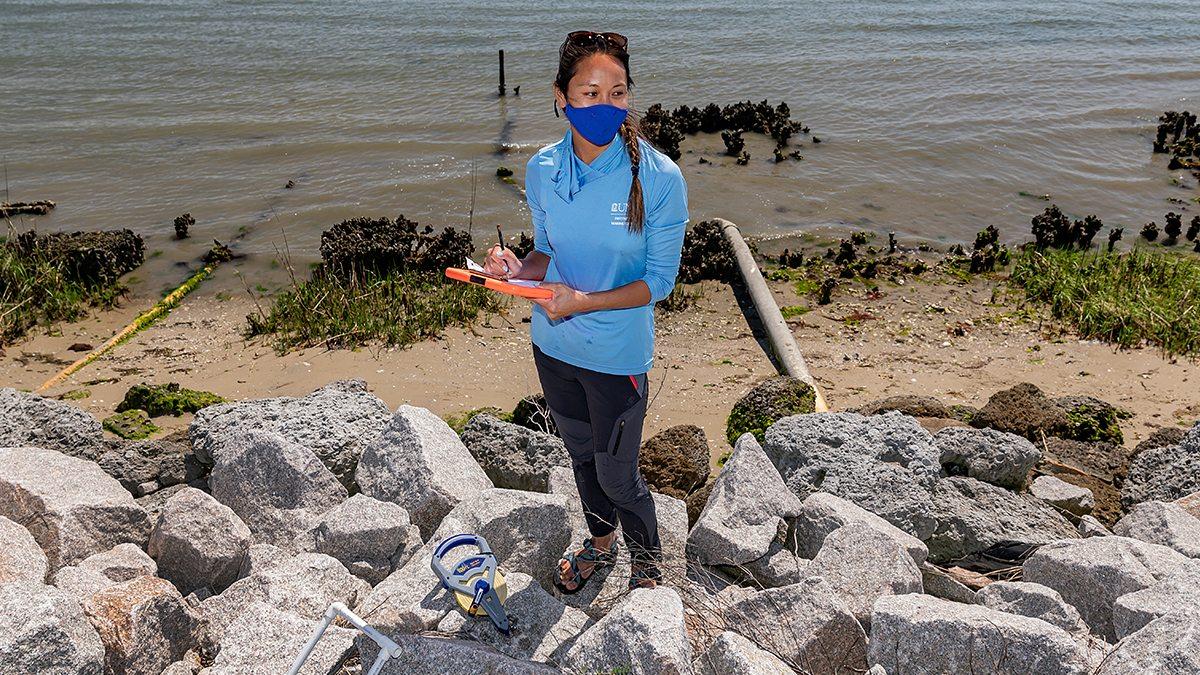 Stacy Zhang standing near the ocean.