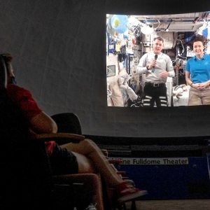 A video of Megan McArthur and Shane Kimbrough in the International Space Station being projected onto the planetarium dome.