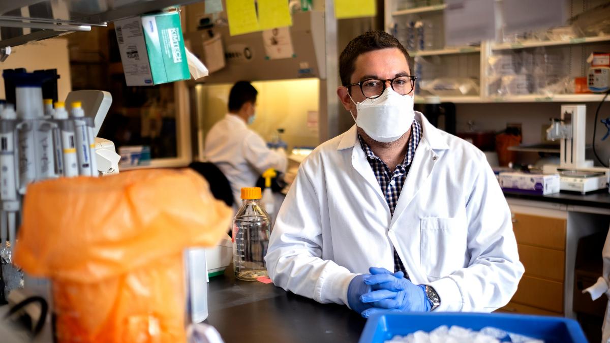 David R. Martinez sitting in his lab.