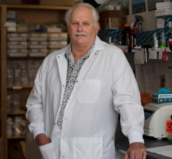 Ralph Baric standing in his lab.