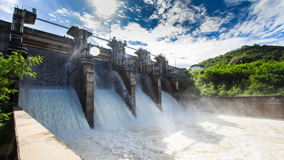Water flows over a dam.