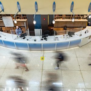 Students walk past the front desk of Davis Library.