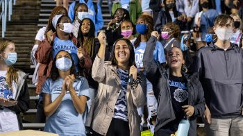 Student cheer in the stands of Kenan Stadium.