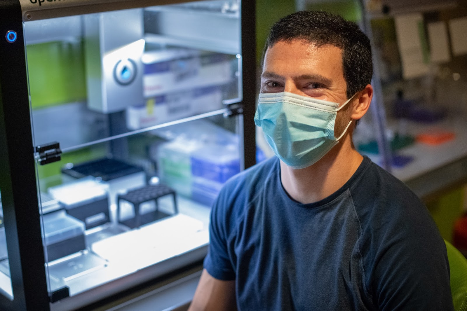 Jeremey Wang poses for a photo in his research lab.