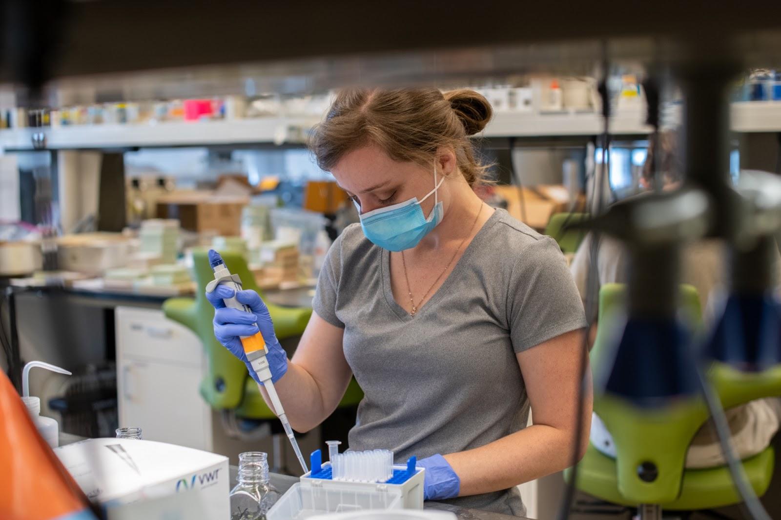 Brianna de la Houssaye working in a lab.