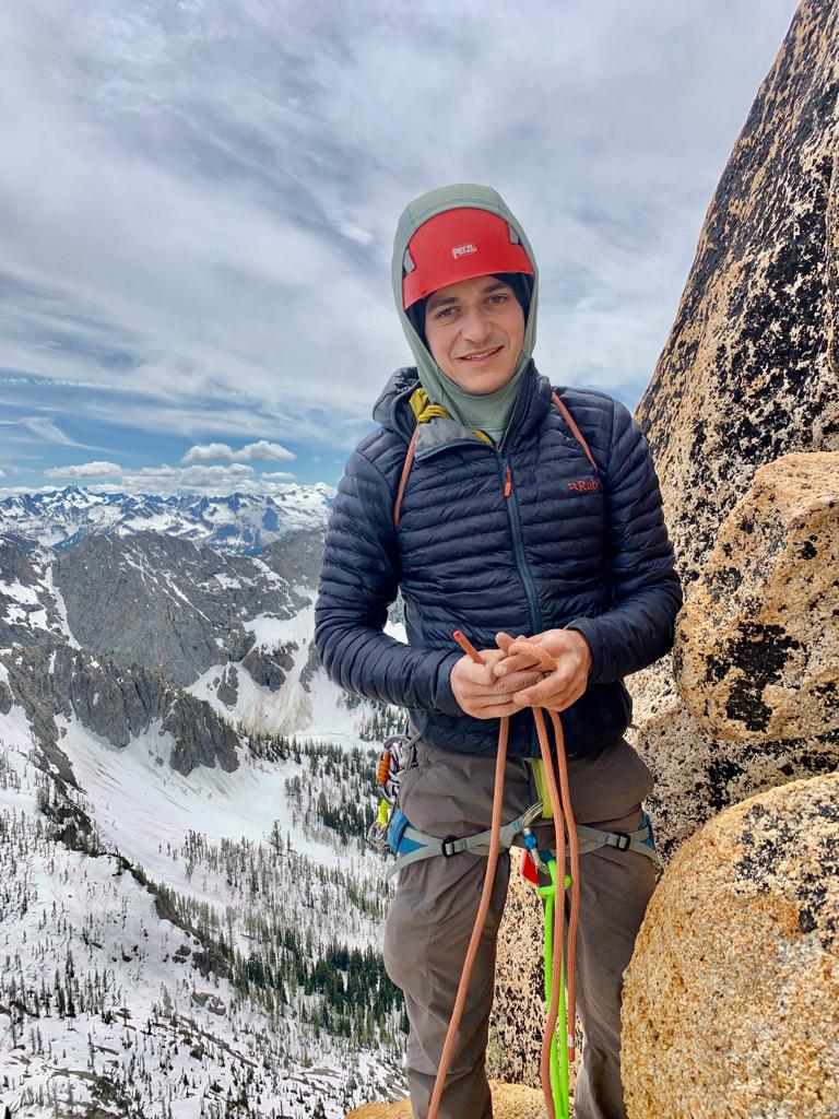 Andrew Buchanan standing on a rock ledge.