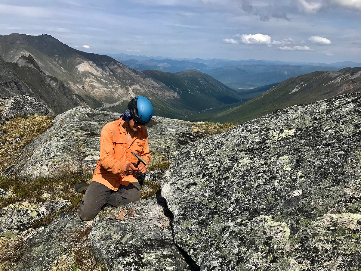 Owen Ryerson collects samples from the Arrigetch Peaks.
