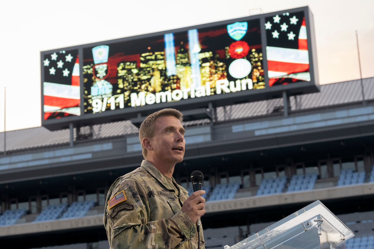 Lt. Col. Dan Hurd speaking at the podium