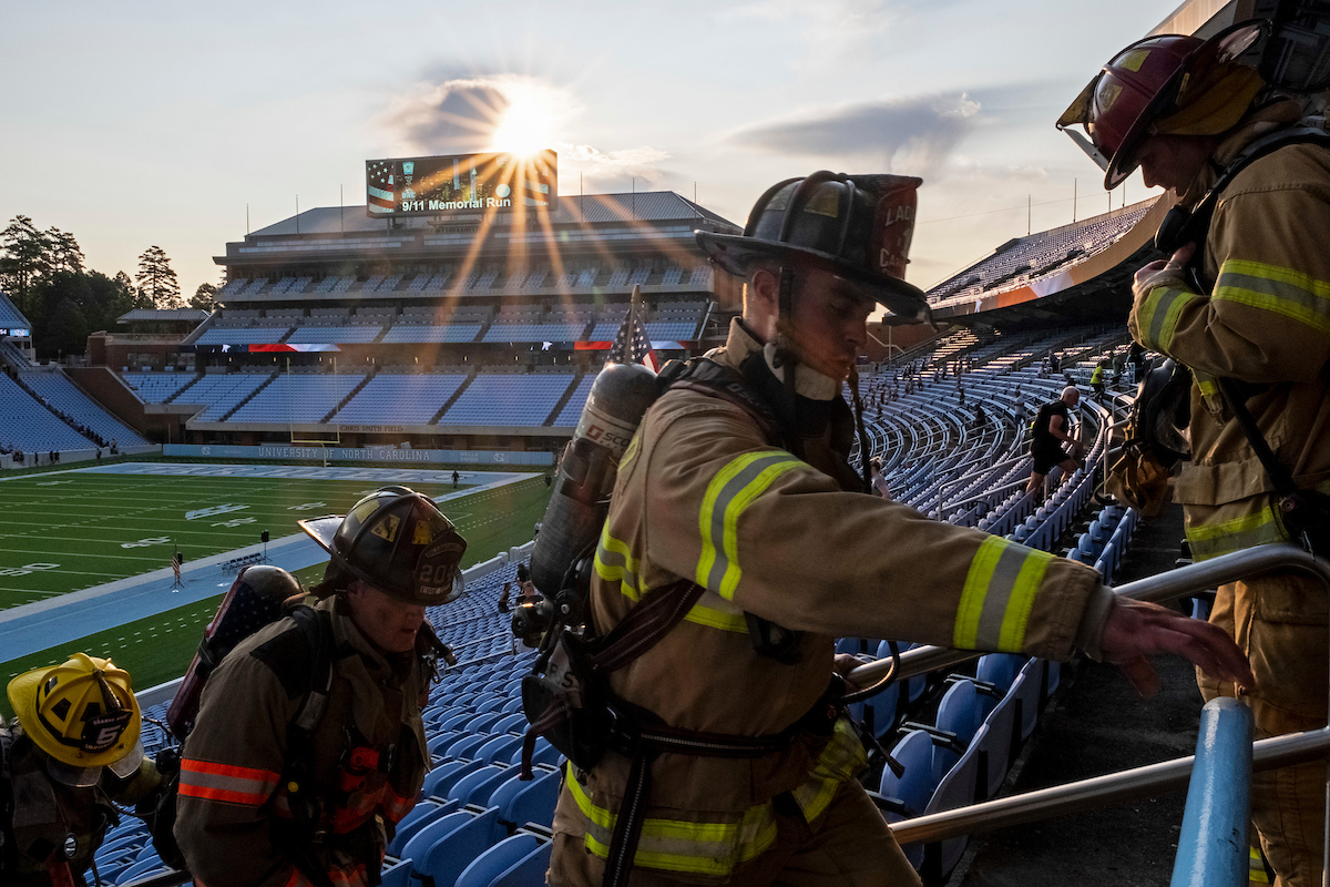Firefighters climbing stairs.