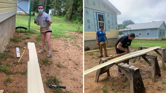 Students working on construction at a habitat for humanity build.