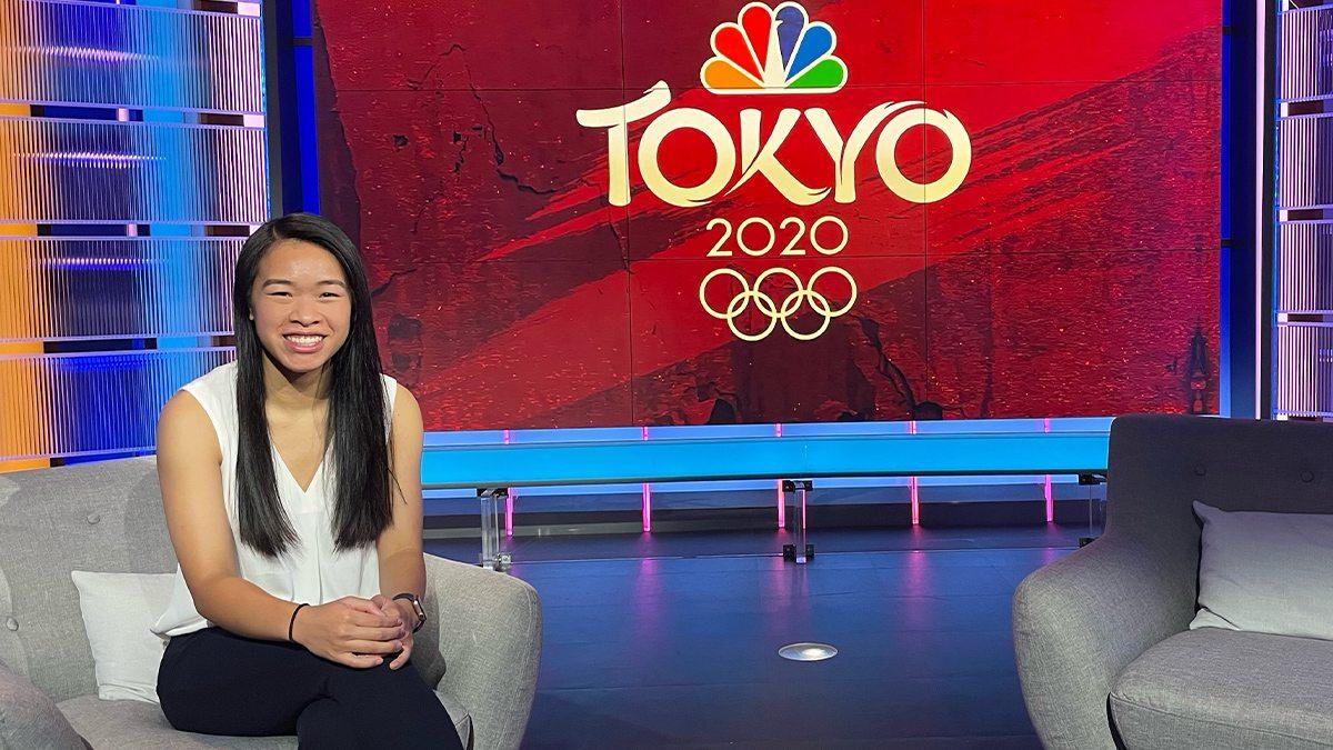Marisa sitting on the of NBC Sports