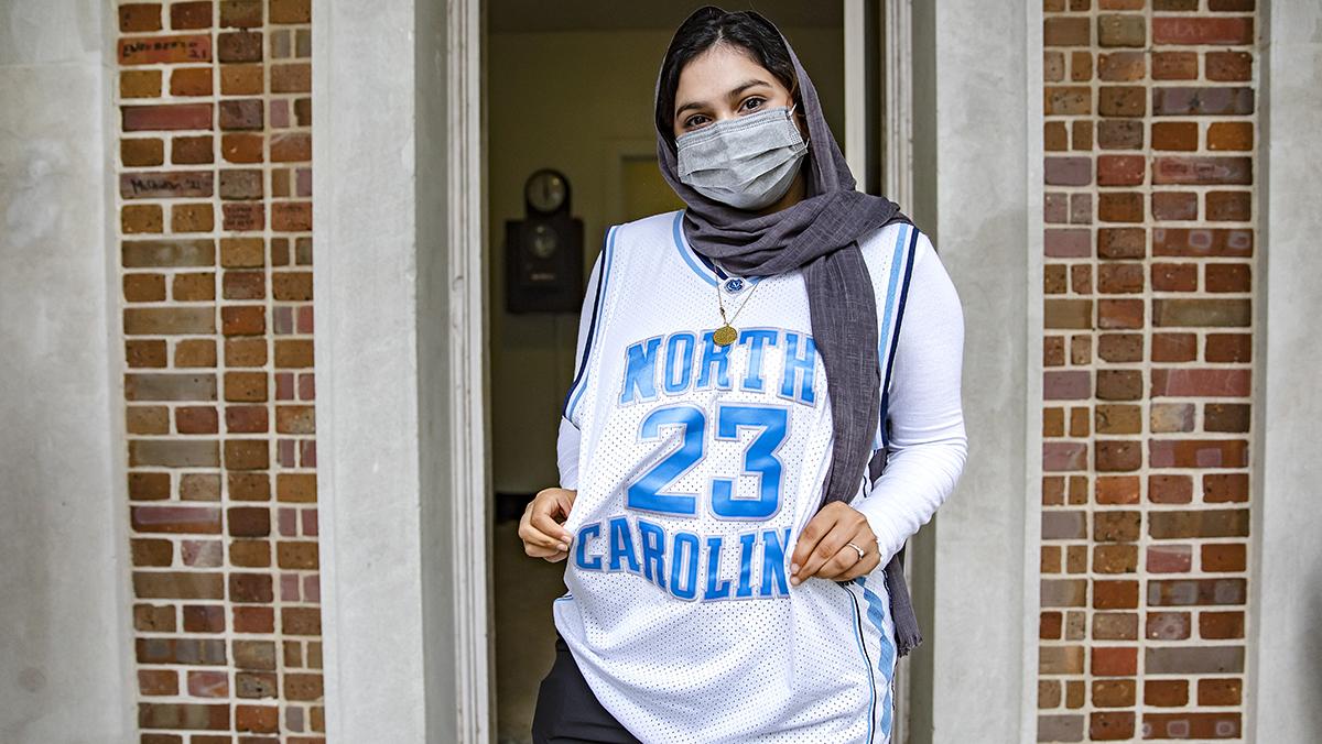 A woman in a michael jordan jersey.