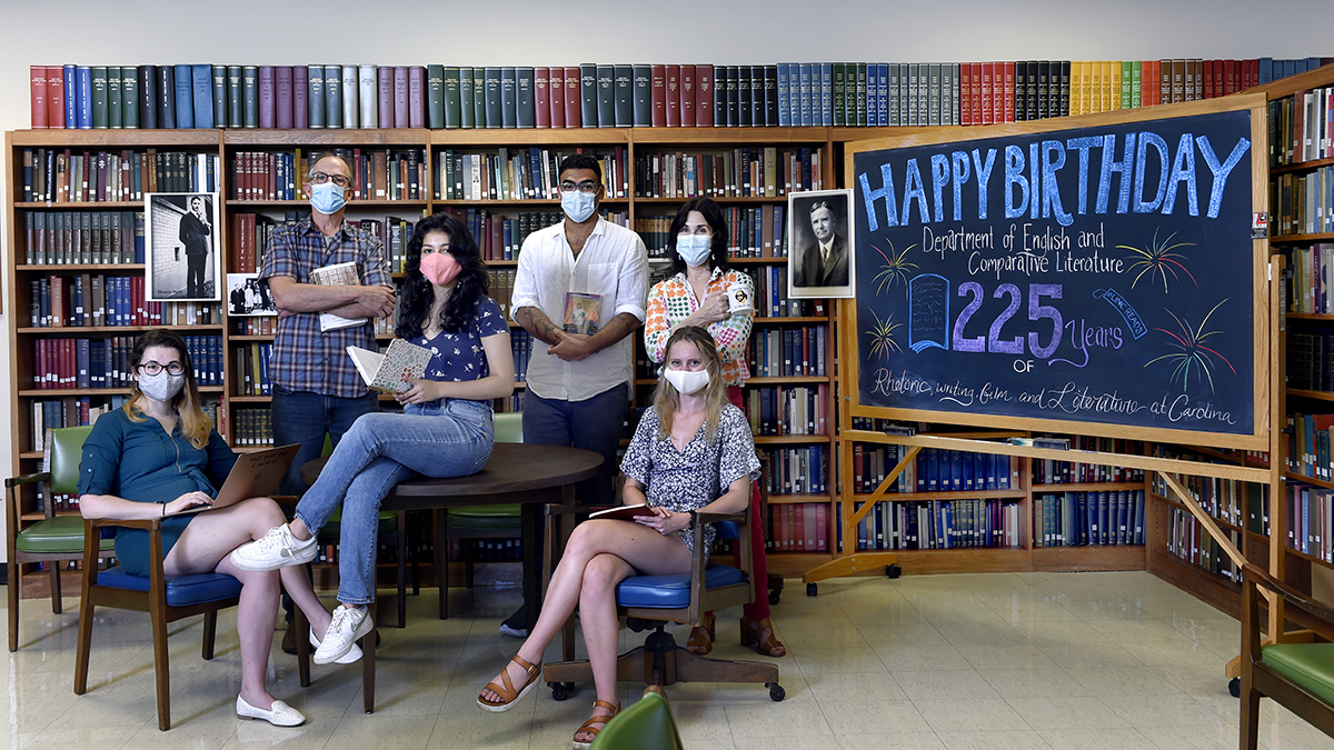 A group holding books in a library.