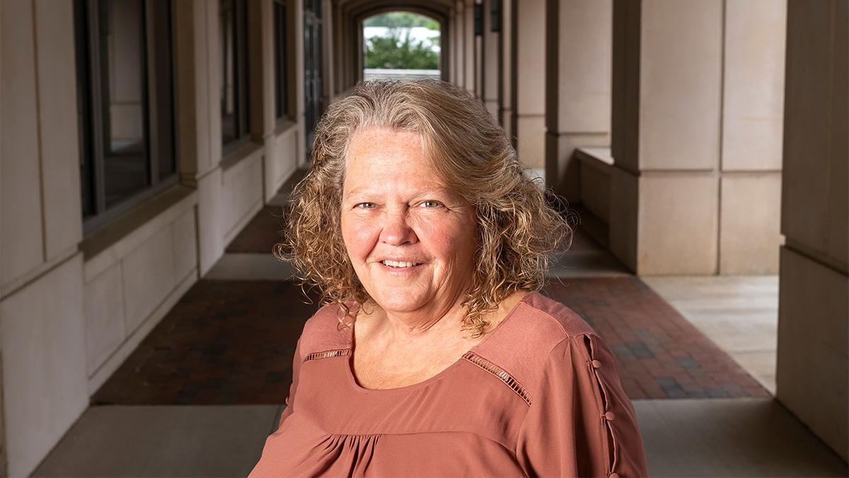 Kathy James standing outside.